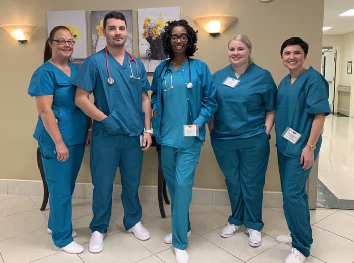 five nurses in uniform
