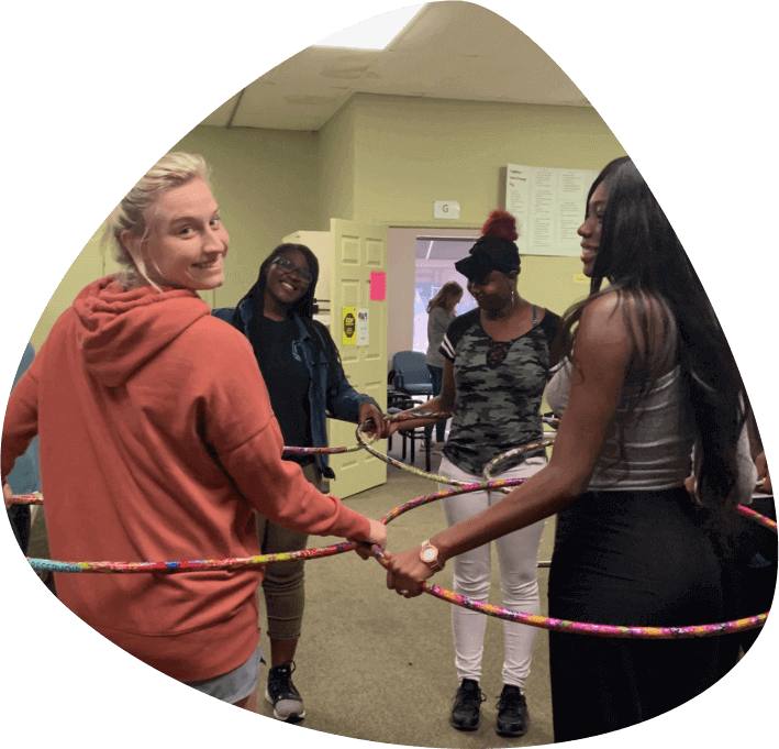 young students doing hoola hoop